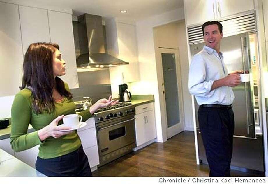 CHRISTINA KOCI HERNANDEZ/CHRONICLE  Gavin Newsom at home with wife, Kimberly Guilfoyle Newsom in the kitchen. Photo: CHRISTINA KOCI HERNANDEZ