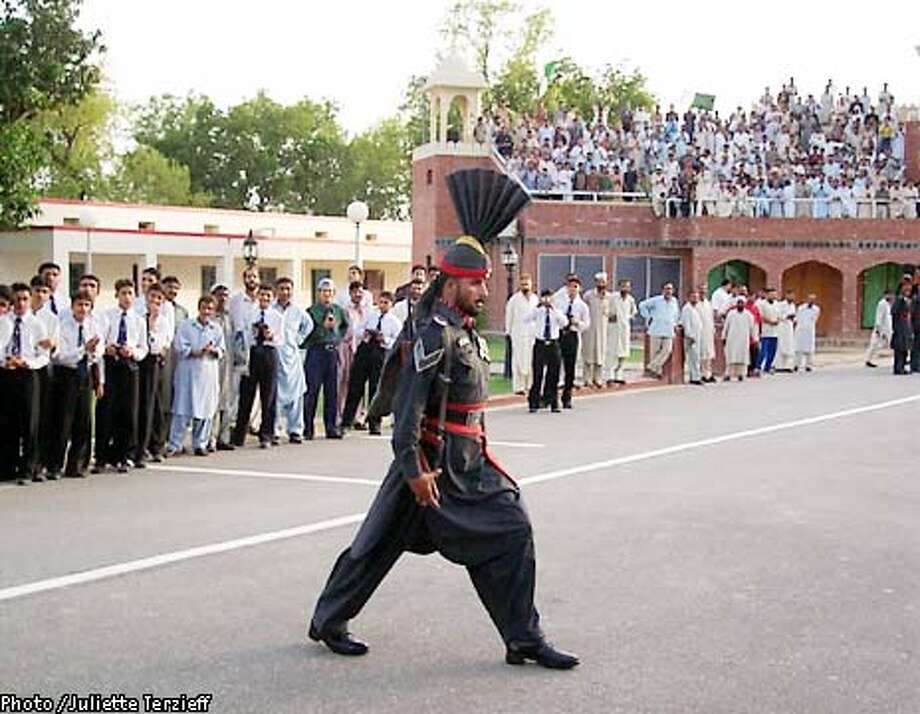 Member of the Pakistani Rangers, elite border troops, menaces his Indian counterparts as part of Flag Lowering Ceremony at the Wagha border crossing. Photo by Juliette Terzieff