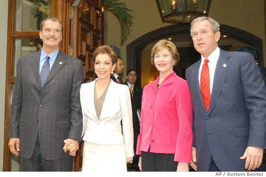 From left to right: Mexican President Vicente Fox, Mexico's first lady Marta Sahagun, first lady Laura Bush and President Bush, pose for a photo after a press conference during the Special Summit of the Americas in Monterrey, Mexico, Monday, Jan. 12, 2004. (AP Photo/NOTIMEXGustavo Benitez) Photo: GUSTAVO BENITEZ