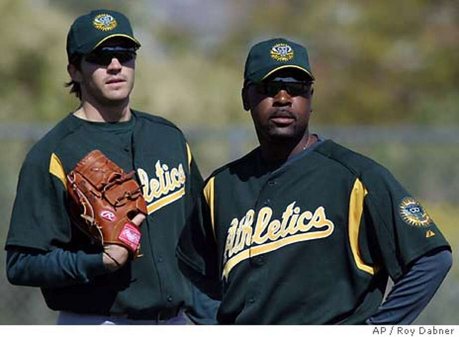 Oakland Athletics pitchers Barry Zito, left, and Arthur Rhodes watch a play at first during drills, Thursday, Feb 26, 2004, at the Athletics spring training facility, in Phoenix.(AP Photo/Roy Dabner) Photo: ROY DABNER