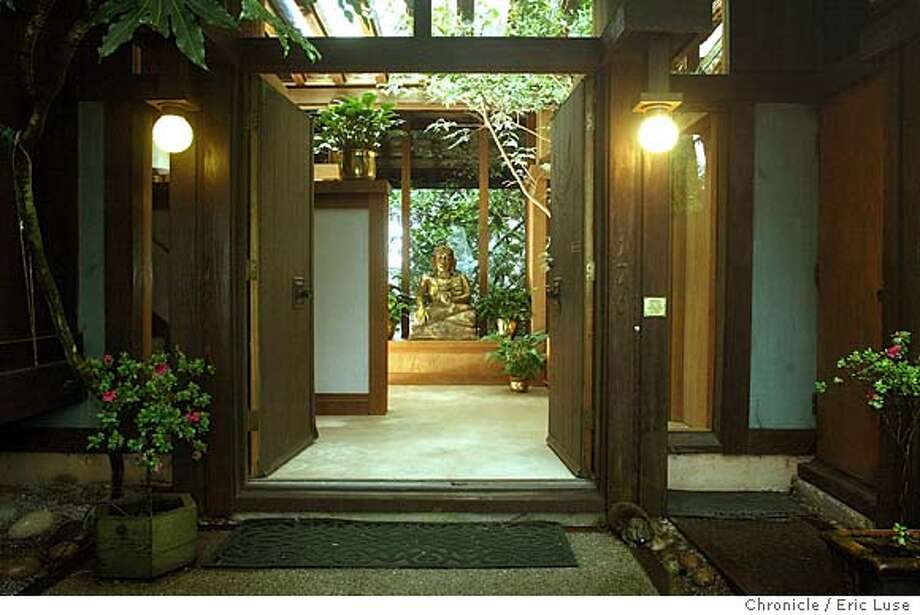 Front door entrance to their home Gwendolyn Duncan-Evans and her husband own this home built by architect Warren Callister, we need a photo of a house he built on top of Twin Peaks in San Francisco known as the Duncan house. Three planks of wood are consistently used where one would do to create rhythm and visual texture, and where the two-story window that overlooks San Francisco from Twin Peaks is divided into three views by immense and deeply recessed wooden piers, each sculpted of multiple wooden members.  Adding further drama to the house is a vaulted roof of laminated wood. 3/1/04 San Francisco. Eric Luse / The Chronicle Photo: Eric Luse