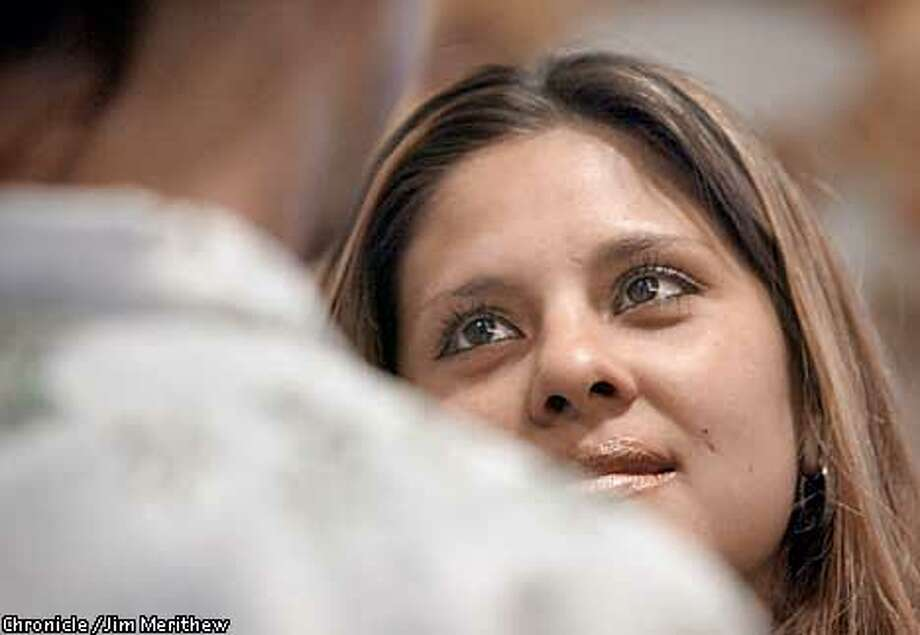 Viviana Barboza looks into her husband to be, Victor Maciel (510-532-8119), eyes as he recites his vows. The Oakland couple got married in the wedding room of the Alameda County Recorder's Building in downtown Oakland May 17, 2002. Jim Merithew/San Francisco Chronicle Photo: Jim Merithew