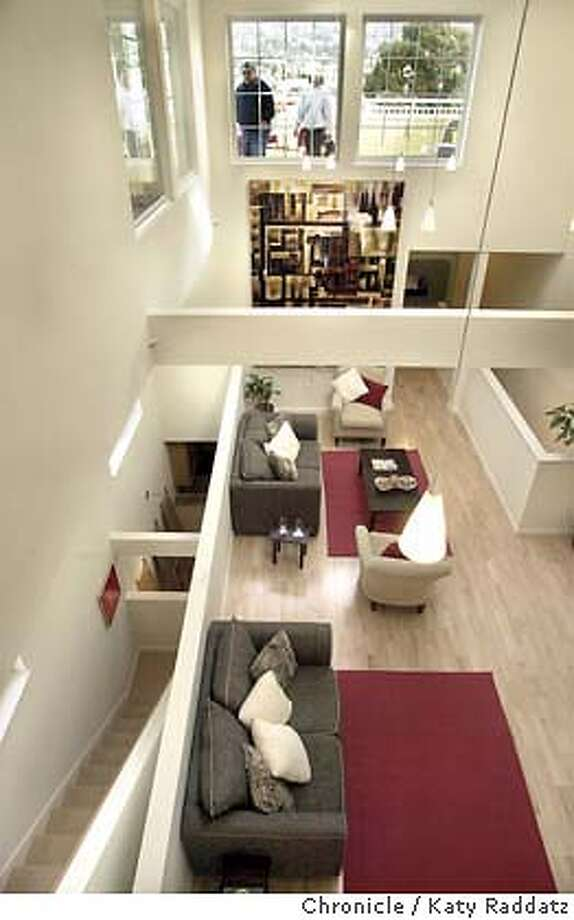 SHOWN: The upstairs living area in the 3-bedroom unit, also showing the deck in the front of the building (people are standing on it) and the staircases leading up to this area. Model Home feature showing a unit at Albany Commons, 914 San Pablo Ave., Albany. Katy Raddatz / The Chronicle Photo: Katy Raddatz