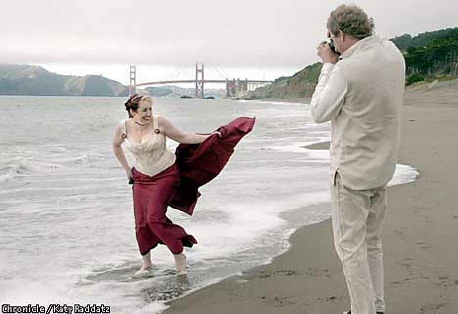 PHOTO BY KATY RADDATZ--THE CHRONICLE  THE DRESS. Shown: Bride-to-be Mars Stone (L) takes her wedding dress, a wonderful custom corset-bodiced creation from Dark Garden corset shop in San Francisco, out for a trial spin on Baker Beach. Mars frolics in the sand and surf while her uncle Howard Stone takes pictures of her. Photo: KATY RADDATZ