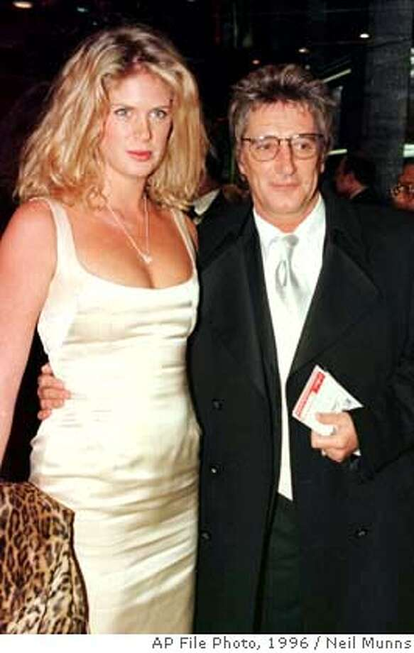 STEWART/C/07DEC98/DD/AP-British singer-songwriter Rod Stewart and his wife Rachel Hunter, seen together in this Dec. 19, 1996 photo, have seperated after eight years of marriage, according to an announcement by Stewart's management company in London late Thursday Dec. 7, 1999. Stewart was 45 when he married New Zealand-born Hunter, then 21, a model with the New York Ford model agency. The couple has two children, Liam, 4, and Renee, 6. (AP Photo/Neil Munns) BY ASSOCIATD PRESS ALSO RAN: 06/30/2000, 11/17/02, 06/03/03