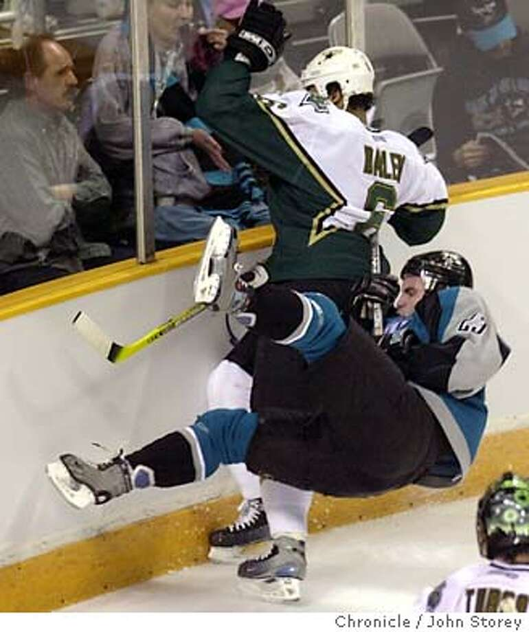 The Sharks vs, the Dallas Stars at the HP Pavillion.  1/13/04 in San Jose. Niko Dimitrakos of the Sharks gets upended by Trevor Daley of the Stars in the 1st period. John Storey / The Chronicle Photo: John Storey