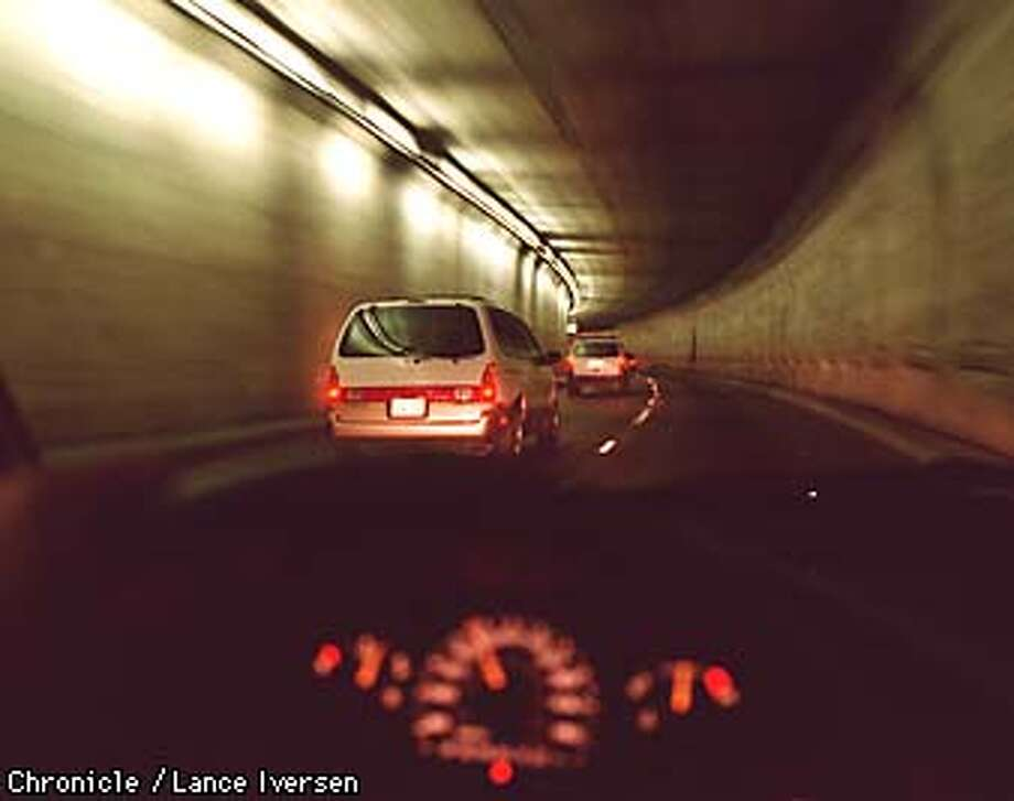 Traffic moves through the Caldecott Tunnel east bound after the middle bore was switched at 190pm going west. By Lance Iversen/San Francisco Chronicle Photo: LANCE IVERSEN