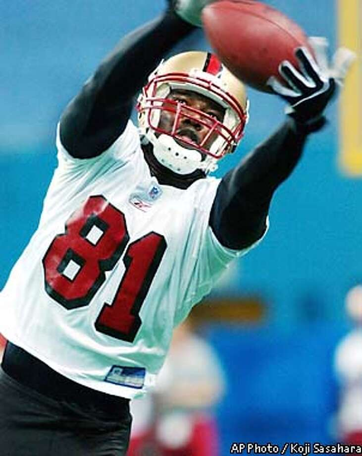 San Francisco 49ers wide receiver Terrell Owens catches a ball during a practice at Osaka Dome Friday, Aug. 2, 2002 in Osaka, western Japan. The 49ers will play an NFL exhibition game against the Washington Red Skins Sunday at the stadium. (AP Photo/Koji Sasahara) Photo: KOJI SASAHARA