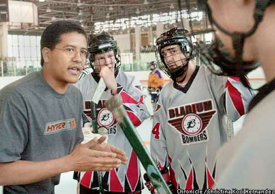 CHRISTINA KOCI HERNANDEZ/CHRONICLE  Coach Maytheni Allen coaches the Bladium Bombers during a competition in Alameda. The Bladium Bombers are competing in an inline hockey competition in Canada. Photo: CHRISTINA KOCI HERNANDEZ