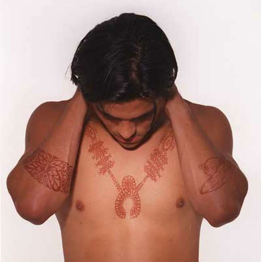 Richard Castaneda models a henna tatoo done by artist Sonja Henderson. CHRONICLE PHOTO BY DEANNE FITZMAURICE