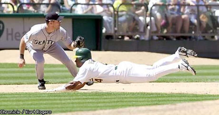 Miguel Tejada took third in the 7th inning and also hit a 3run homer in the 3rd The Oakland A's Vs the Seattle Mariners .Photo By Kurt Rogers Photo: Kurt Rogers