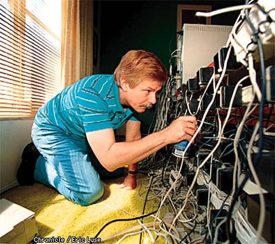 After experiencing his phone lines going down Internet provider Ken Braun checks and cleans each of his roughly 100 modems everyday.  Photo by Eric Luse Photo: Eric Luse
