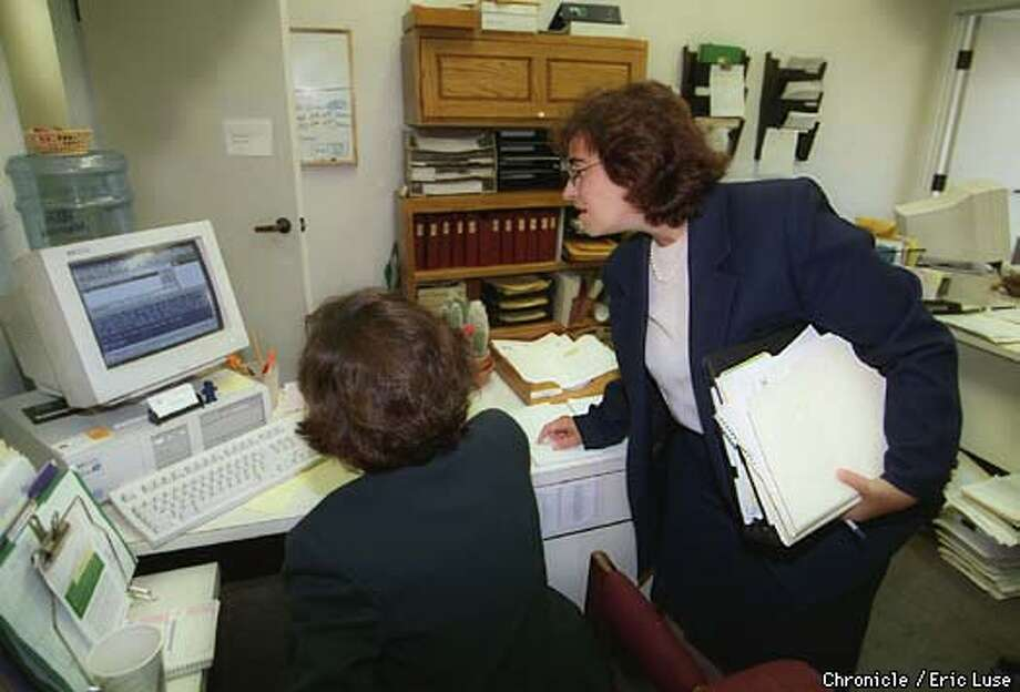 Supervisor Leslie Katz looks over a e-mail with aide Deb Dubin in her City Hall offices.  Photo Eric Luse Photo: Eric Luse