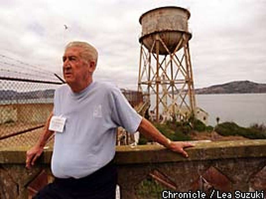 Former Resident, Jim Quillen, looks over the exercise yard atop Alcatraz where he was for 10 years. Photo By Lea Suzuki