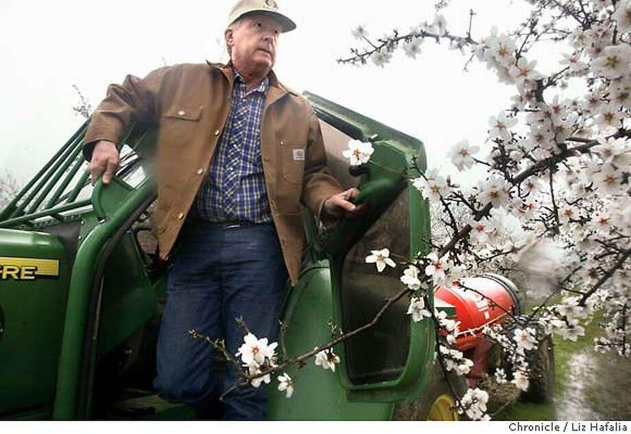 Almond farmer Gerry Rominger in his orchard with a sprayer. Shot on 3/1/04 in Arbuckle. LIZ HAFALIA / The Chronicle Photo: LIZ HAFALIA