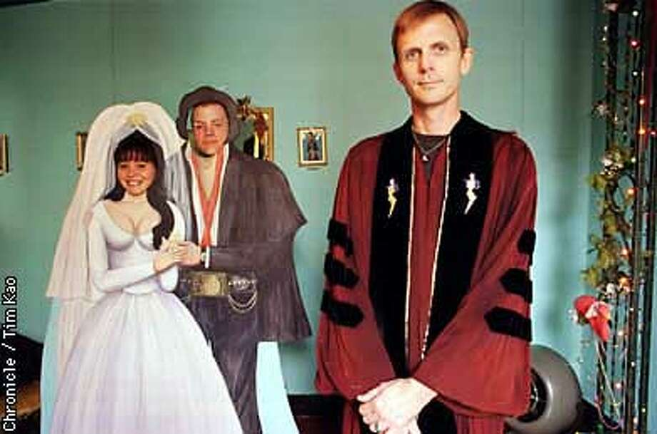 =TOMMY Foster got ordained as a priest through one of those back of the magazine mail order churches for $25. Couple can pose with the cutout behind him for $3, or $2 with own camera. photo by Tim Kao/the chronicle Photo: TIM KAO