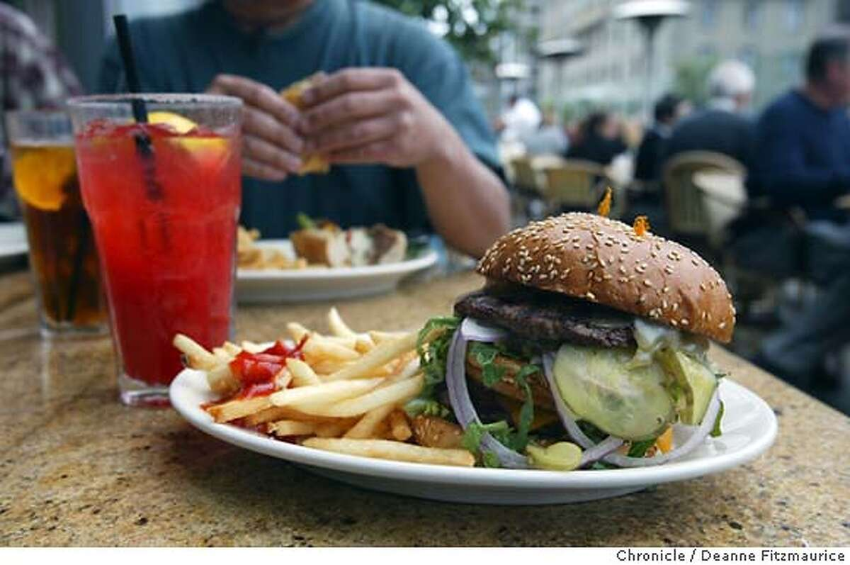 """Portions, such as this """"Tons of Fun"""" hamburger, are large at the Cheesecake Factory on Union Square. Deanne Fitzmaurice / The Chronicle"""