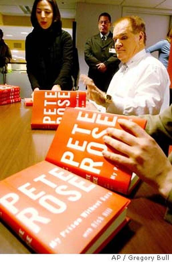 Pete Rose, top right, signs copies of his new book ``Pete Rose: My Prison Without Bars,'' in New York, Friday, Jan. 9, 2004. Rose acknowledges in the book that was released Thursday, that he bet on baseball. (AP Photo/Gregory Bull) Photo: GREGORY BULL