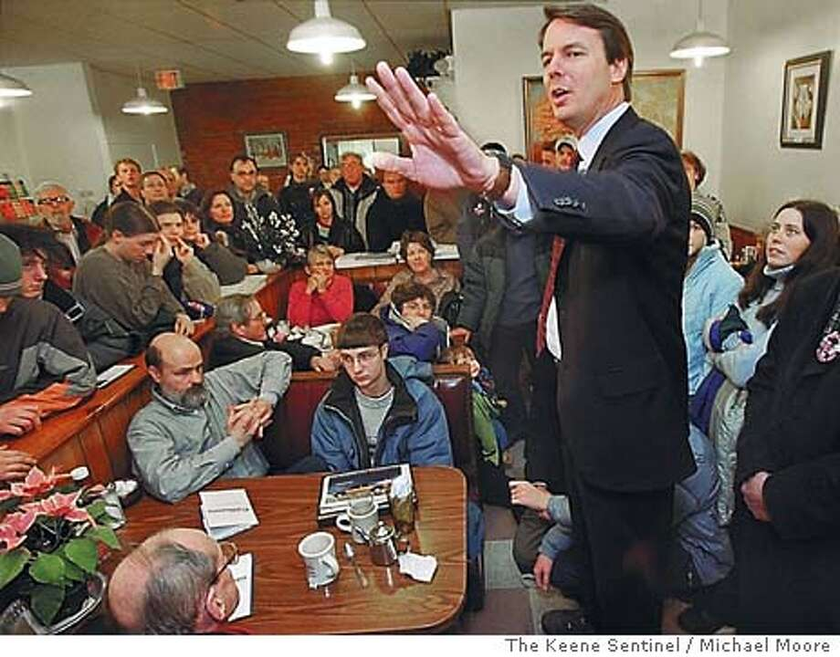 Democratic presidential hopeful Sen. John Edwards of North Carolina stumps in front of an overflow crowd at Timoleon's Restaurant in Keene, N.H. on Friday Jan. 9, 2004. (AP Photo/The Keene Sentinel / Michael Moore) Photo: MICHAEL MOORE