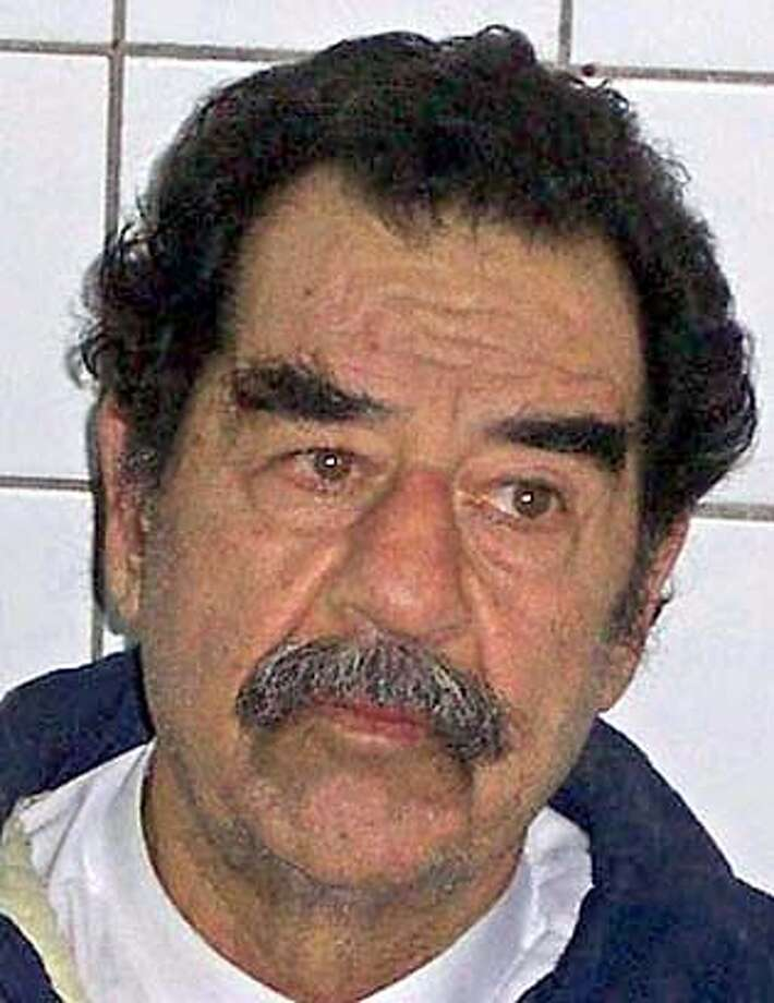 Undated file picture shows the former Iraqi president Saddam Hussein shortly after he was arrested by the U.S. troops in Iraq. Officials from the International Committee of the Red Cross (ICRC) visited former Iraqi leader Saddam Hussein on February 21, 2004, an ICRC spokeswoman said. HO 0 #######0421631726 Saddam Hussein, seen after his arrest in December, is being held in Iraq as a U.S. prisoner of war. ProductNameChronicle ProductNameChronicle #######0421631726 Saddam Hussein, seen after his arrest in December, is a U.S. prisoner of war in Iraq. ProductNameChronicle Photo: HO