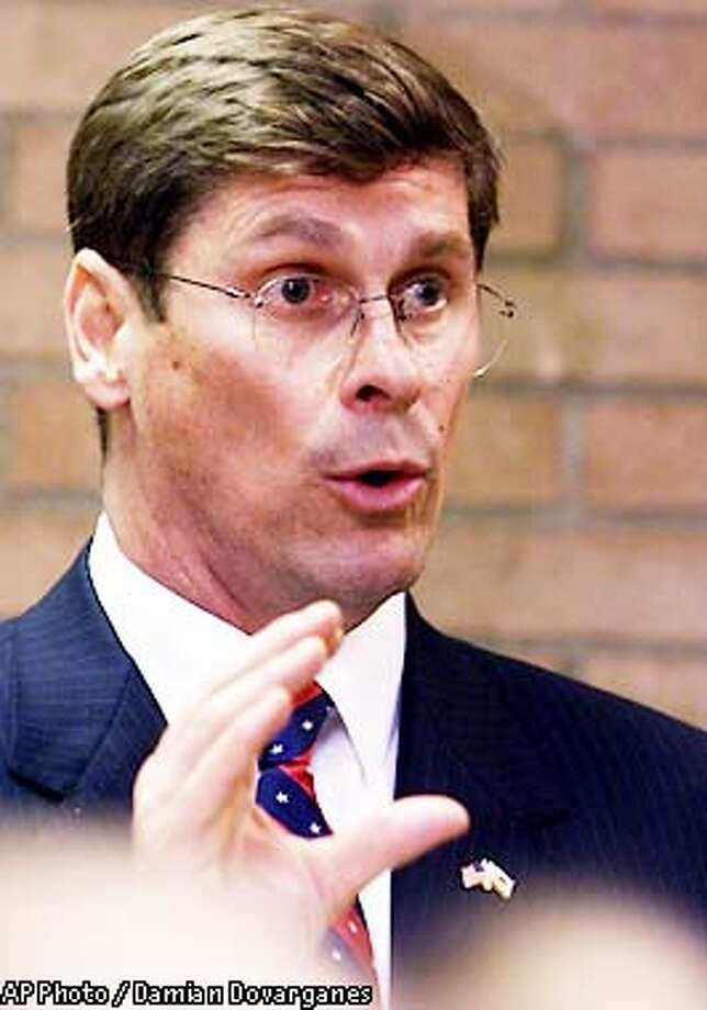 """California Republican gubernatorial candidate Bill Simon speaks during a news conference at the University of Southern California, Tuesday, June 4, 2002, in Los Angeles. Simon said that Democratic Gov. Gray Davis' fiscal policies pose a threat to local law enforcement. """"The resources available to local law enforcement to protect public safety have been put at risk by the current administration's gross mismanagement of the state budget,"""" Simon said in an address to the Criminal Justice Legal Foundation,a conservative victims' rights group. Simon, a wealthy financier who served three years as an assistant U.S. attorney in New York in the mid-80's, is making his first run for public office. (AP Photo/Damian Dovarganes) Photo: DAMIAN DOVARGANES"""