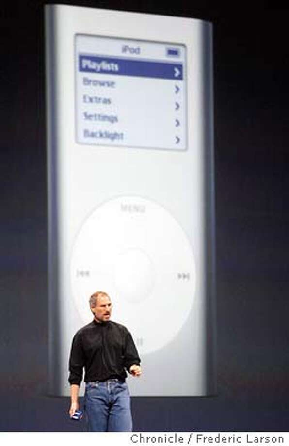 ; Apple chief executive Steve Jobs unveiled a new version of the computer maker's popular digital music device Tuesday, hoping to boost market share in the lucrative niche. The iPod mini that will debut in February for $249 will hold about 1,000 digital songs. It will be about the size of a business card and a half-inch thick. City:� 1/6/04, in San Francisco, CA. City:� .  Frederic Larson/The Chronicle; Photo: Frederic Larson