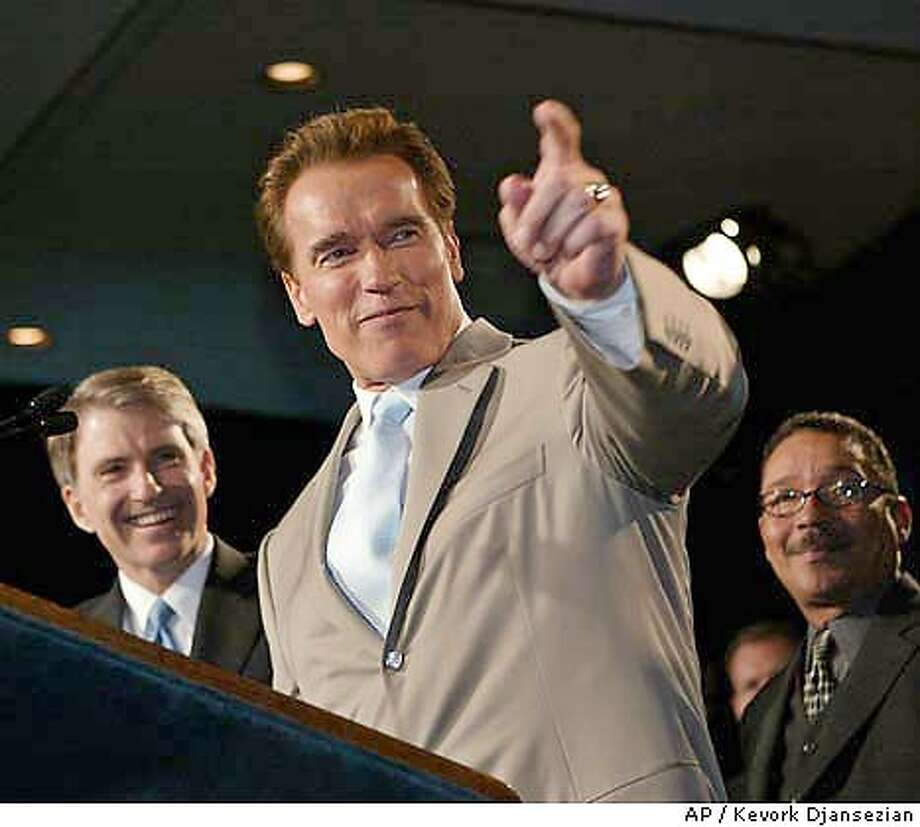 California Gov. Arnold Schwarzenegger, center, is joined by State Controller Steve Westly, left, and State Speaker Emeritus Herb Wesson at a victory party for state ballot Propositions 57 and 58 at a Santa Monica, Calif., hotel Tuesday, March 2, 2004. The measures, a centerpiece of Schwarzenegger's plan to solve the state's financial woes, approve $15 billion in borrowing and restrict borrowing in the future. (AP Photo/Kevork Djansezian) #######0421653122 Gov. Arnold Schwarz- enegger has eclipsed the president as the GOP's marquee name. ProductNameChronicle ProductNameChronicle Photo: KEVORK DJANSEZIAN