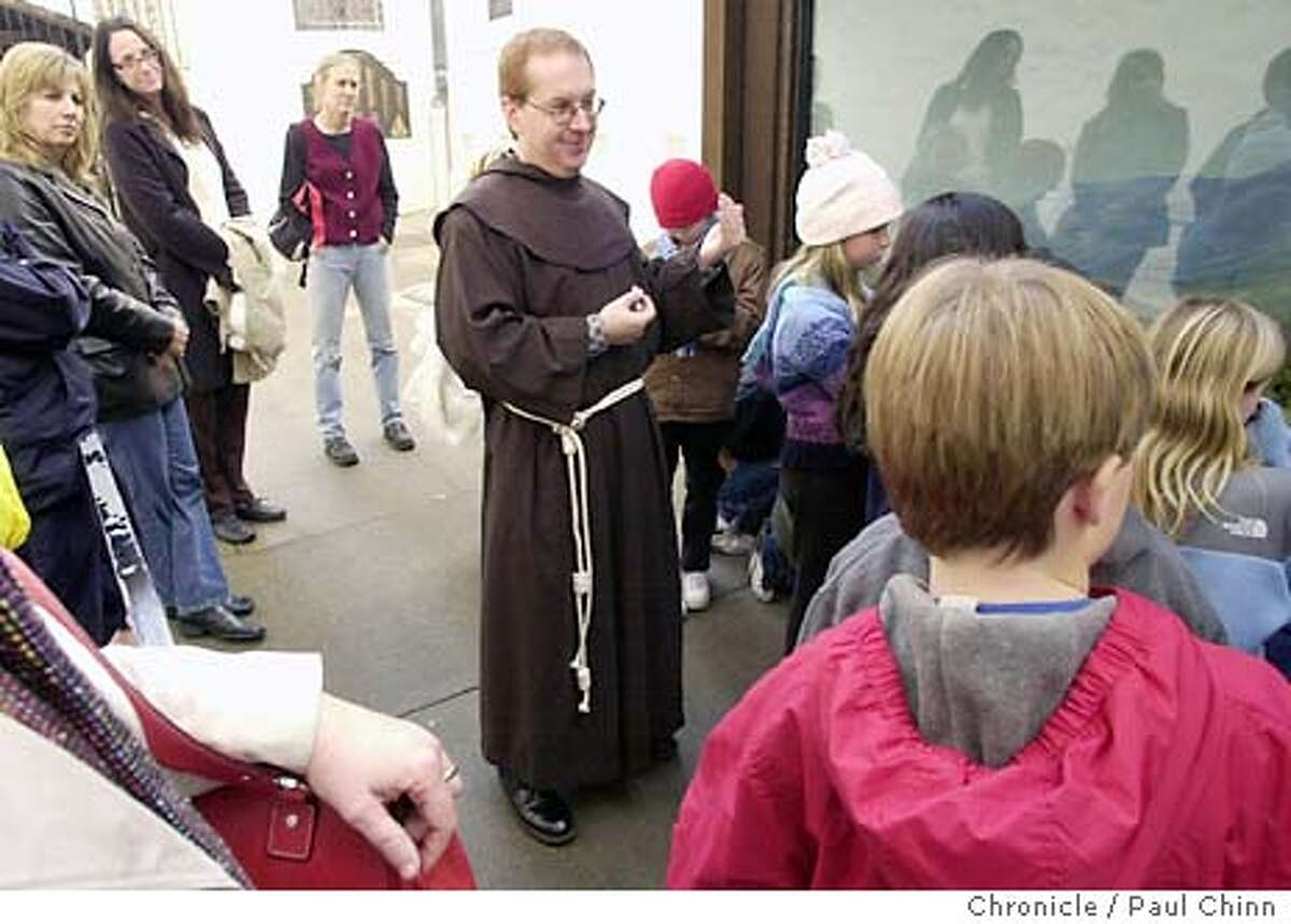 mission064_pc.jpg Brother Guire Cleary conducts a tour for students visiting from Mill Valley. Andrew Galvin, an Ohlone Indian, will take over next month as curator of the mission and replaces Brother Guire Cleary. Mission Dolores in San Francisco on 1/8/04. PAUL CHINN / The Chronicle