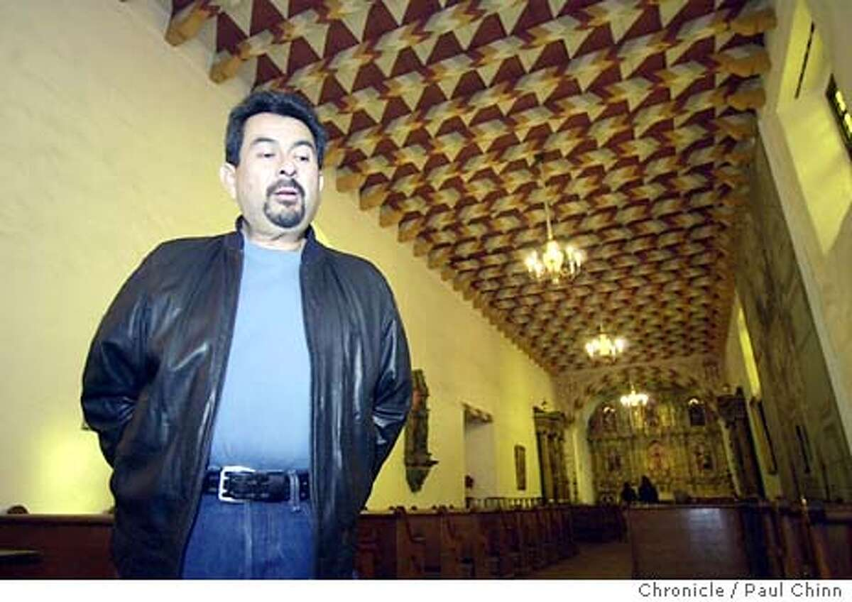 mission084_pc.jpg Andrew Galvin inside the mission's church. Galvin, an Ohlone Indian, will take over next month as curator of the mission and replaces Brother Guire Cleary. Mission Dolores in San Francisco on 1/8/04. PAUL CHINN / The Chronicle