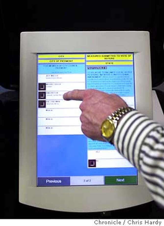 Alameda county registrar Brad Clark demonstrates electronic voting machine after a few crapped out during yesterdays election  Event on 3/3/04 in Oakland. Chris Hardy / The Chronicle Photo: Chris Hardy