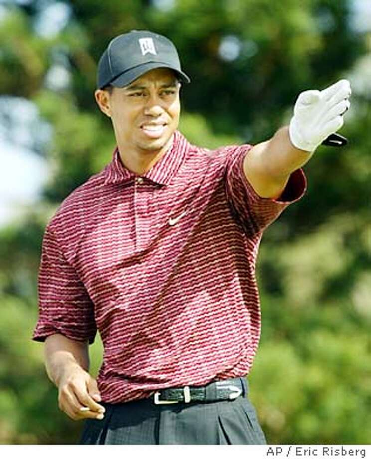Tiger Woods checks the wind direction before hitting from the 2nd tee of the Plantation Course during the final round of the Mercedes Championships in Kapalua, Hawaii Sunday Jan. 11, 2004.(AP Photo/Eric Risberg) Photo: ERIC RISBERG
