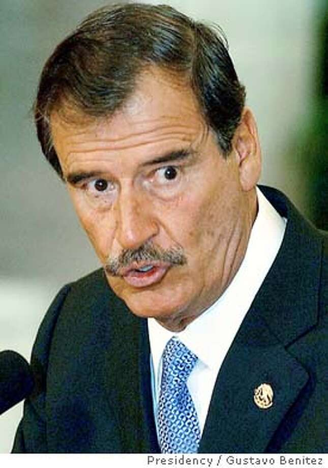 Mexican President Vicente Fox speaks with foreign correspondents at the presidential residence Los Pinos in Mexico City, January 9, 2004. Three days before the meeting of leaders at a regional summit in Mexico, Fox said he will meet privately with U.S. President George W. Bush and urge him to give Mexican migrants special treatment and to further open borders between the two nations and Canada. REUTERS/HO/Presidency / Gustavo Benitez 0 Photo: HO