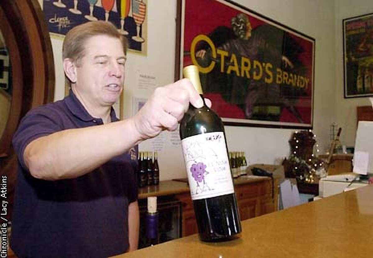 Tom Carew show off Roche wine El Nino Vin in the tasting room of the Roche wineary. PHOTO BY LACY ATKINS/CHRONICLE