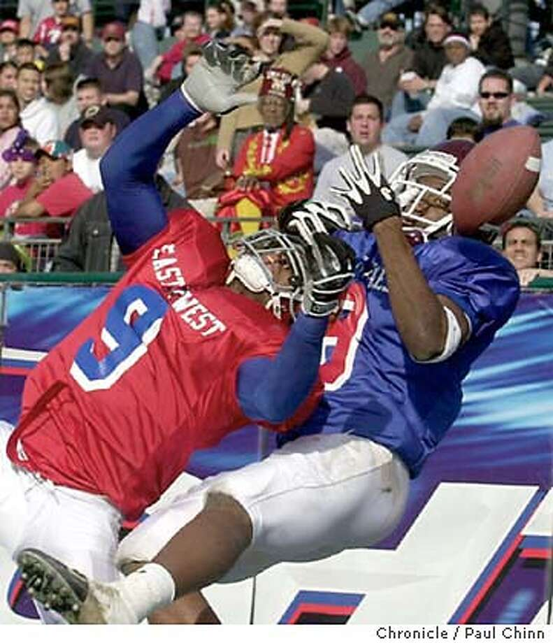 shrinegame256_pc.jpg East wide receiver Justin Jenkins (right) couldn't haul in this pass in the end zone with West defensive back Marcell Allmond (9) providing heavy pressure. The 79th annual East-West Shrine Game at SBC Park in San Francisco on 1/10/04. Second half action. PAUL CHINN / The Chronicle MANDATORY CREDIT FOR PHOTOG AND SF CHRONICLE/ -MAGS OUT Photo: PAUL CHINN