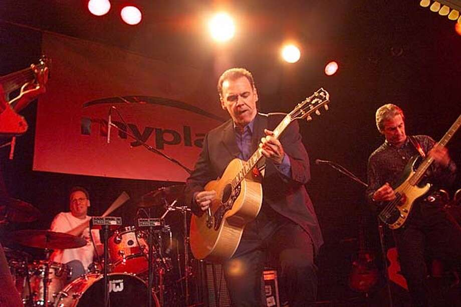"CORP 02-C-13OCT99-DD-MAC Roots rocker John Hiatt plays for big bucks at a private party for a "" MYPLAY"" internet company. Private parties feature big-name pop music talent. John Hiatt takes the stage at the party at Slim's Nightclub in San Francisco. by Michael Macor/The Chronicle Photo: MICHAEL MACOR"