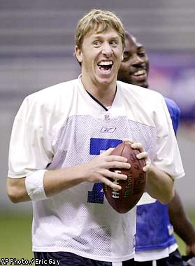 Dallas Cowboys rookie quarterback Chad Hutchinson (7) shares a laugh with teammates during the team's practice at the Alamodome in San Antonio, Thursday, Aug. 1, 2002. The Cowboys will travel to Houston to scrimmage with the Houston Texans Friday. Cowboys line backer Louis Mackey is in the background. (AP Photo/Eric Gay) Photo: ERIC GAY