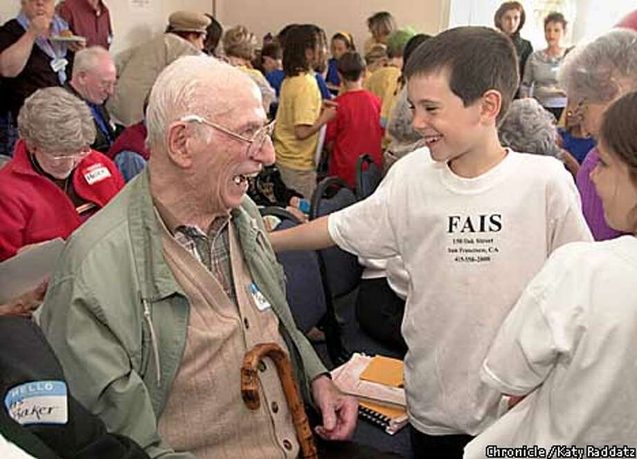 """PHOTO BY KATY RADDATZ--THE CHRONICLE  At the French-American International School in San Francisco, there was a program called """"A -Plus"""" which paired 80 second grade students with senior citizens. SHOWN: Michael O'Farrell (R) shares a laugh with his senior, Tom Baker, who lives at The Carlisle with his wife Eleanor Baker (not shown here). Photo: KATY RADDATZ"""