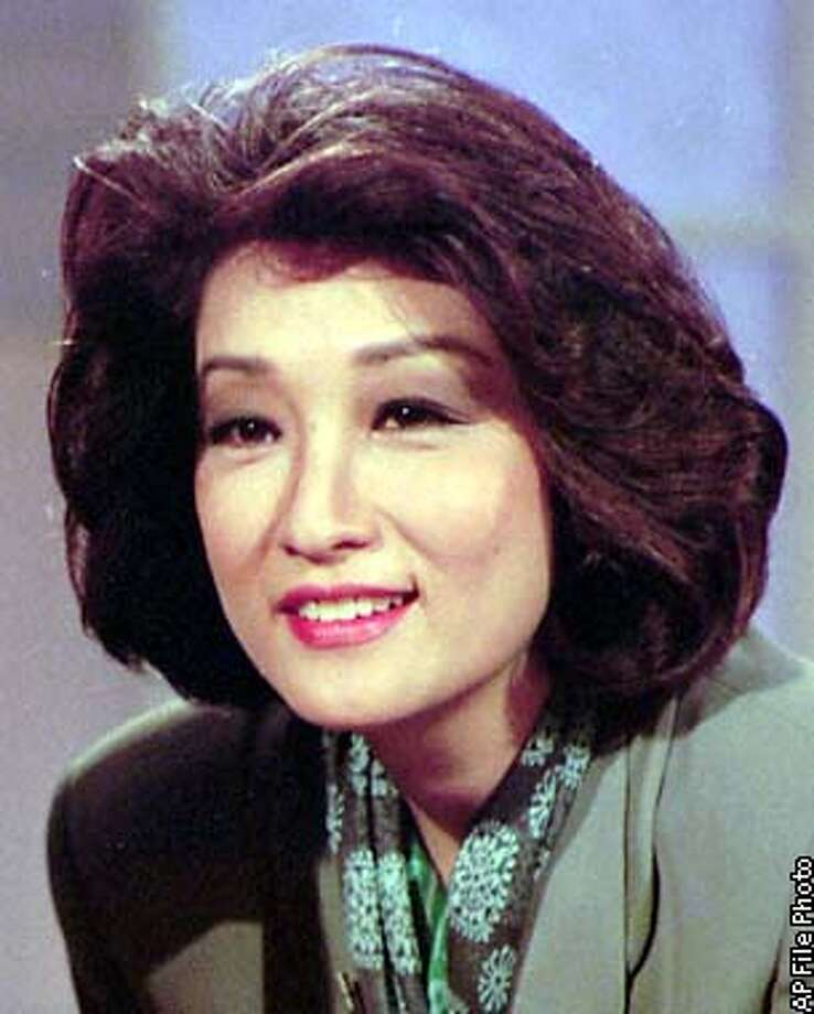 FILE--Former CBS news anchor is shown in an undated file photo. Two years after leaving CBS, Chung will return to the air on ABC. The network held a news conference Monday, Nov. 3, 1997, to announce the hiring of Chung, who will contribute to the newsmagazines ``PrimeTime Live'' and ``20/20'' and be available as a substitute anchorwoman. (AP Photo/File) ALSO RAN 8/21/01