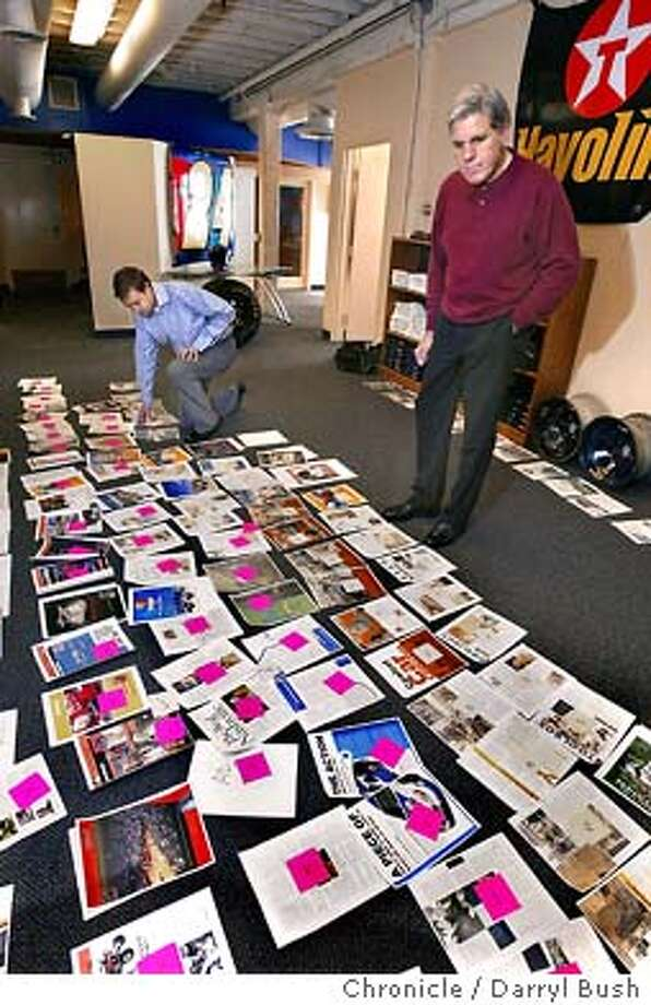 """Editor Lucas Mast, back left, and publisher Val Landi, standing right, look at the upcoming pages for their new magazine intended for NASCAR enthusiasts, """"American Thunder,"""" at their headquarters.  Event on 3/2/04 in San Francisco.  Darryl Bush / The Chronicle Photo: Darryl Bush"""