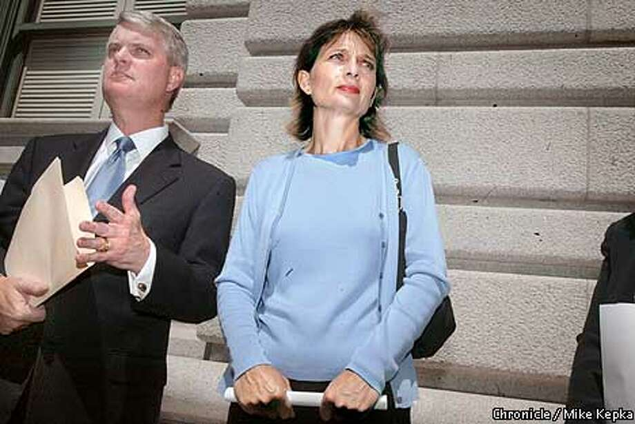 """With her attorney Paul Sullivan by her side in front of the 9the Circuit US Court of Appeals in San Francisco, Sandy Banning held a press conference to say she filed a motion with the court to intervine and her daughter's behalf and says neither she nor her daughter believe there is anything improper about saying the words """"under God,"""" in the Pledge of Allegiance. BY MIKE KEPKA/THE CHRONICLE Photo: MIKE KEPKA"""