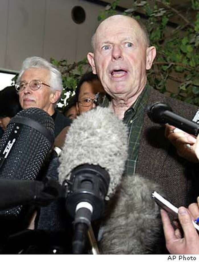 John W. Lewis, professor emeritus of international relations at Stanford University, leading an unofficial American delegation to North Korea, speaks to journalists on the delegation's arrival at Beijing airport from North Korea, Saturday, Jan. 10, 2004. The members said Saturday they visited the disputed Yongbyon nuclear facility but wouldn't say what they saw until they report to Washington, which is trying to arrange a new round of six-nation talks on ending the standoff over the North's nuclear ambitions. At left is Sig Hecker, former director of Los Alamos Laboratory in New Mexico. (AP Photo/Kyodo News) ** JAPAN OUT, , CREDIT MANDATORY **