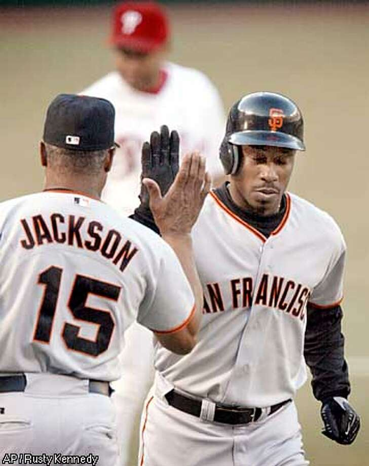 San Francisco Giants' new center fielder Kenny Lofton, right, is congratulated by third base coach Sonny Jackson (15) after Lofton hit a solo home run in the first inning against the Philadelphia Phillies Tuesday, July 30, 2002, in Philadelphia. Lofton was playing as a Giant for the first time since being traded Sunday by the Chicago White Sox. (AP Photo/Rusty Kennedy) Photo: RUSTY KENNEDY