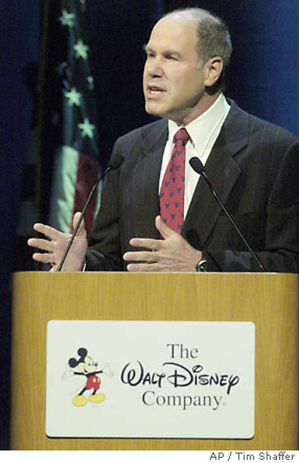 Disney chairman and chief executive Michael Eisner addresses shareholders at their annual meeting in Philadelphia Wednesday, March 3, 2004. Disney is under intense pressure from state pension funds and proxy advisory firms to split the chairman and CEO jobs. (AP Photo/Tim Shaffer, Pool) Photo: TIM SHAFFER