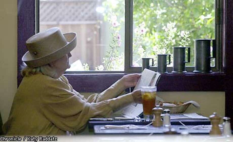 PHOTO BY KATY RADDATZ--THE CHRONICLE  Le Zinc, a restaurant at 4063 24th St.. Very charming. SHOWN: An afternoon customer enjoys the newspaper and the view to the garden before her lunch arrives. Photo: KATY RADDATZ