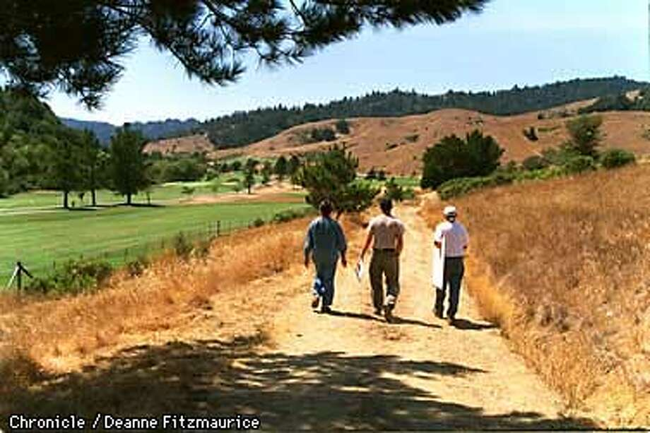 Residents of San Geronimo walk through an area of proposed development of luxury homes in the San Geronimo area of West Marin. These residents are opposed to the development. CHRONICLE PHOTO BU DEANNE FITZMAURICE