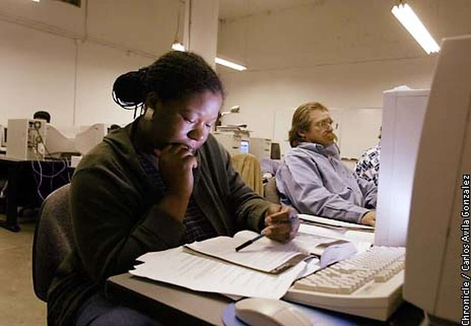 Climiell Thomas of Oakland is taking networking classes through the Cypress Technology Center in Oakland, Ca., on Monday, July 29, 2002. For people of color, recovering from the downturn of the economy may be significantly more difficult. In the rear is Stephen Prince, another student in the program.  (BY CARLOS AVILA GONZALEZ/THE SAN FRANCISCO CHRONICLE) Photo: CARLOS AVILA GONZALEZ