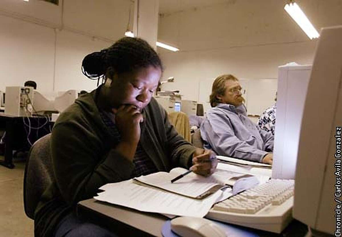 Climiell Thomas of Oakland is taking networking classes through the Cypress Technology Center in Oakland, Ca., on Monday, July 29, 2002. For people of color, recovering from the downturn of the economy may be significantly more difficult. In the rear is Stephen Prince, another student in the program. (BY CARLOS AVILA GONZALEZ/THE SAN FRANCISCO CHRONICLE)