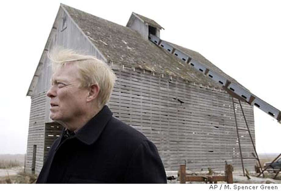 Presidential hopeful Sen. Dick Gephardt, D-Mo. talks to reporters on the farm of Robert and Joyce Ausberger Thursday, Jan. 8, in Jefferson, Iowa. (AP Photo/M. Spencer Green) Photo: M. SPENCER GREEN