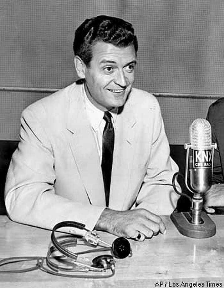 ** FILE ** Veteran Los Angeles Lakers announcer Chick Hearn is shown in a photo taken in the early 1960s. Hearn, who made phrases like ``slam dunk'' and ``air ball'' common basketball expressions during his 42-year career with the Los Angeles Lakers, died Monday. He was 85. (AP Photo/Los Angeles Times)