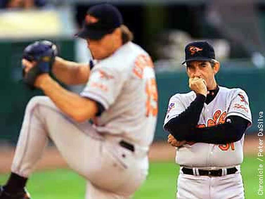 Baltimore Orioles pitching coach Ray Miller keeps his eye on starting picher Scvott Erickson before their game against the A's Friday the Aug. 1, 1997.Chronicle Photo By: Peter DaSilva Photo: Peter DaSilva